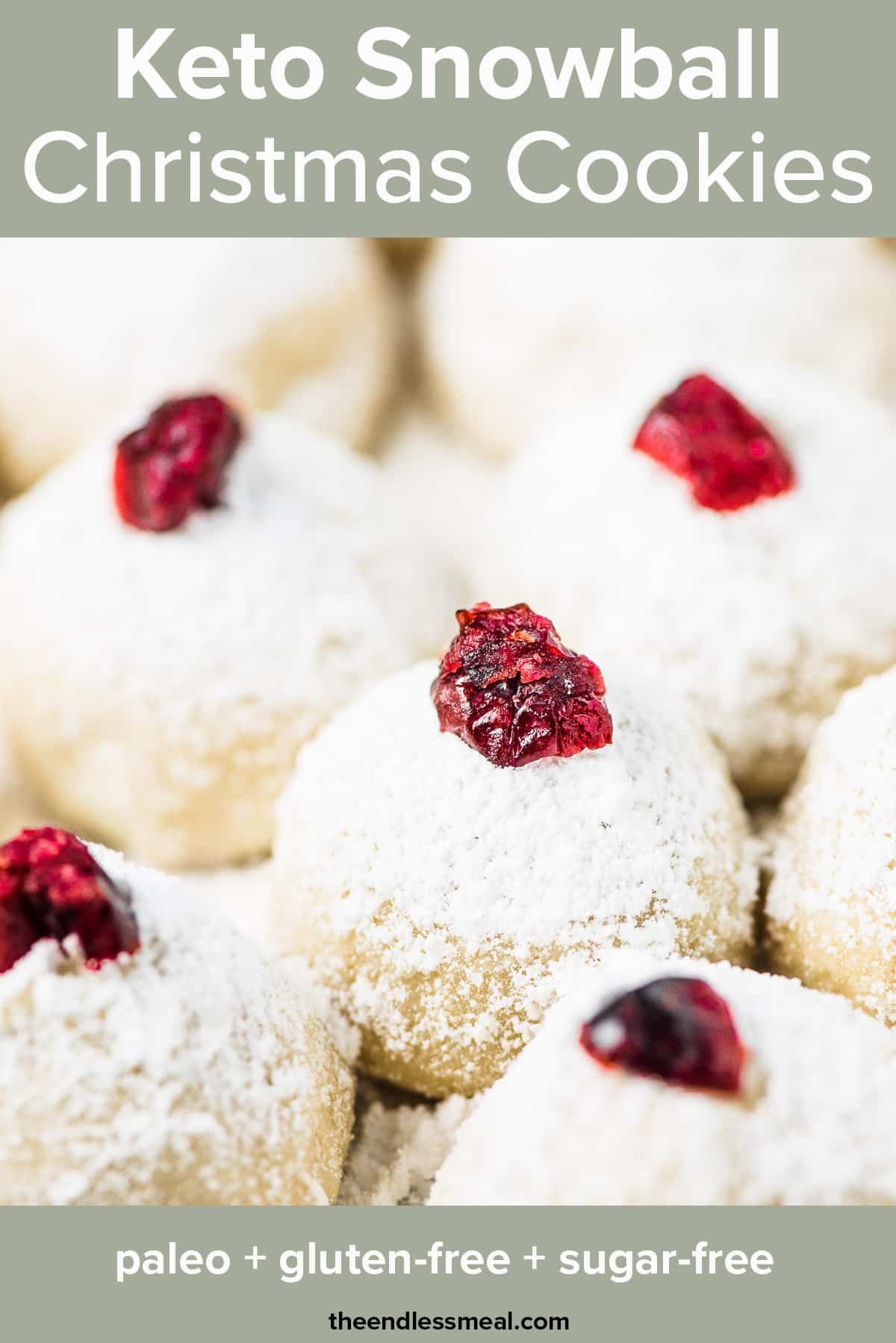 A closeup of keto Christmas cookies topped with cranberries and the recipe title on top of the picture.
