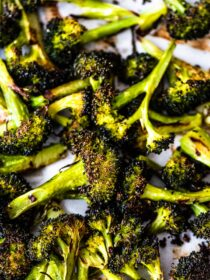 Roasted broccoli on a baking sheet