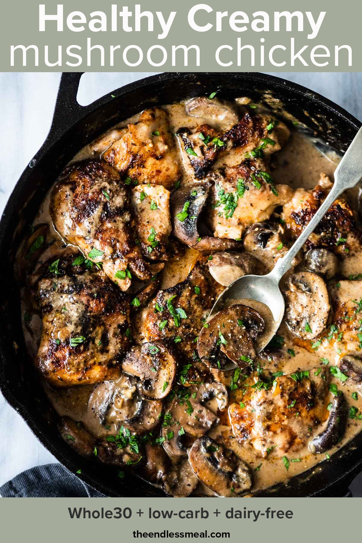 This creamy mushroom chicken recipe in a cast iron pan with a spoon in it and the recipe title on top of the picture.