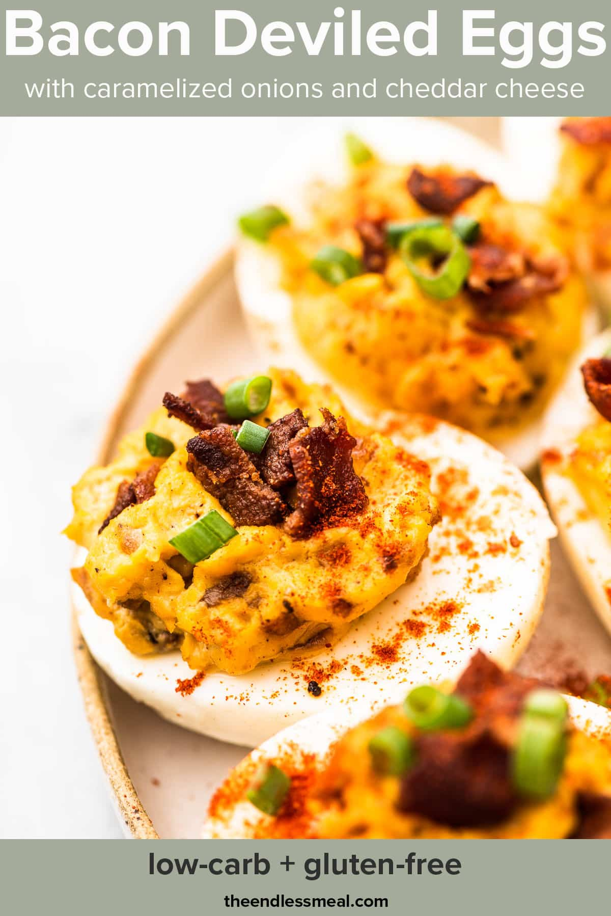 Deviled eggs with bacon and topped with green onions on a plate with the recipe title on the picture.