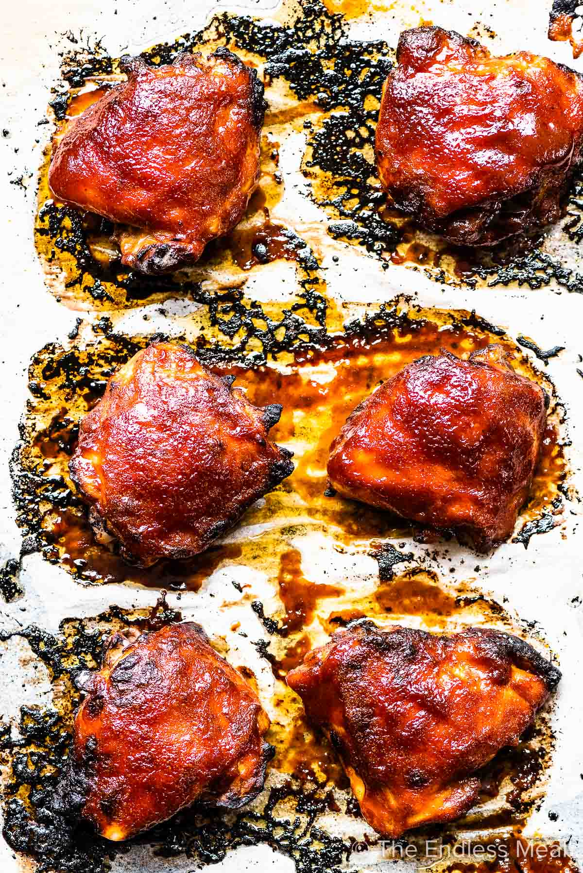Oven baked bbq chicken on a baking sheet.