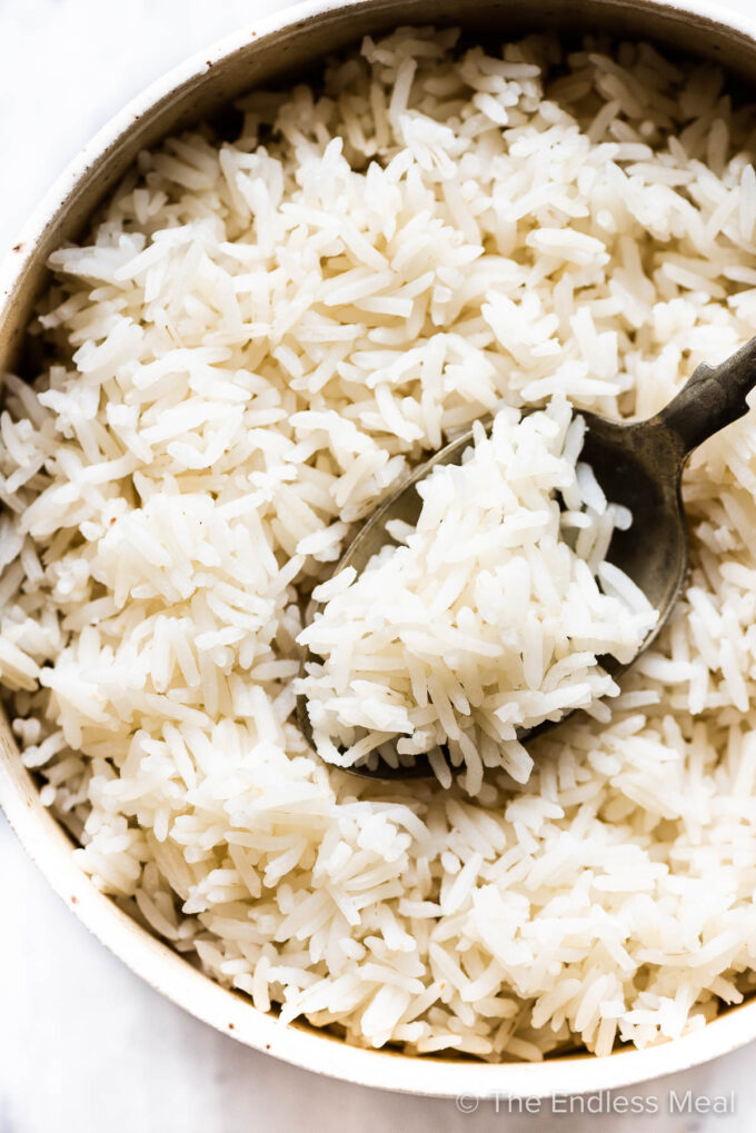 Fluffy basmati rice in a bowl with a spoon.