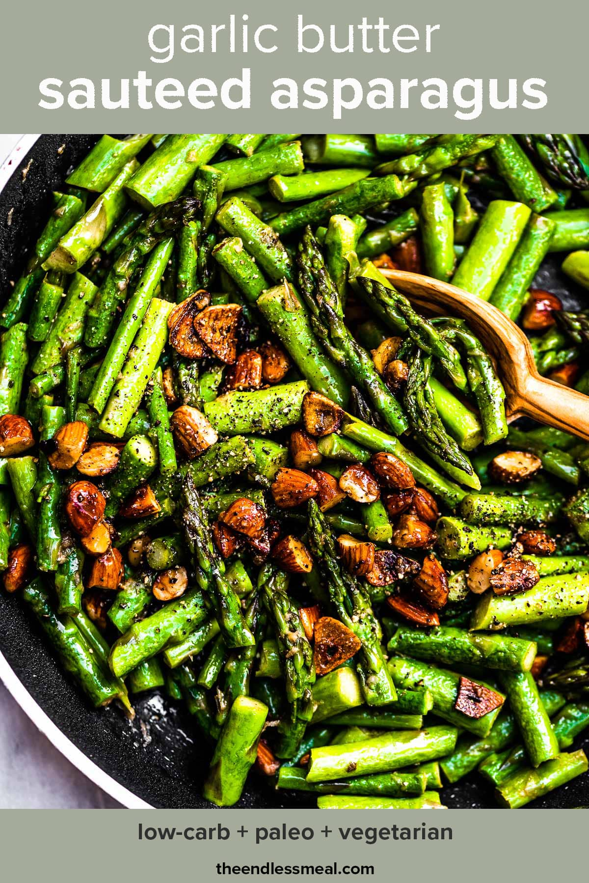 Garlic butter asparagus in a black pan with the recipe title on top of the picture.