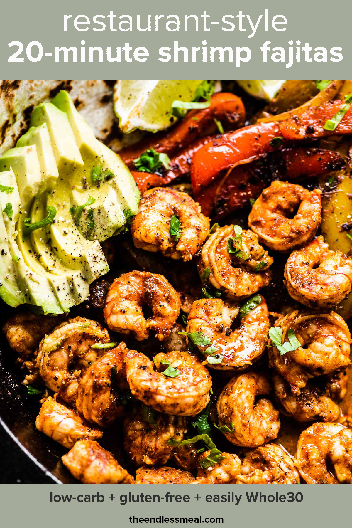 A close up of shrimp fajitas in a pan with avocado and limes with the recipe title on top of the picture.