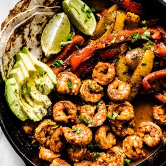 Shrimp fajitas in a cast iron pan,