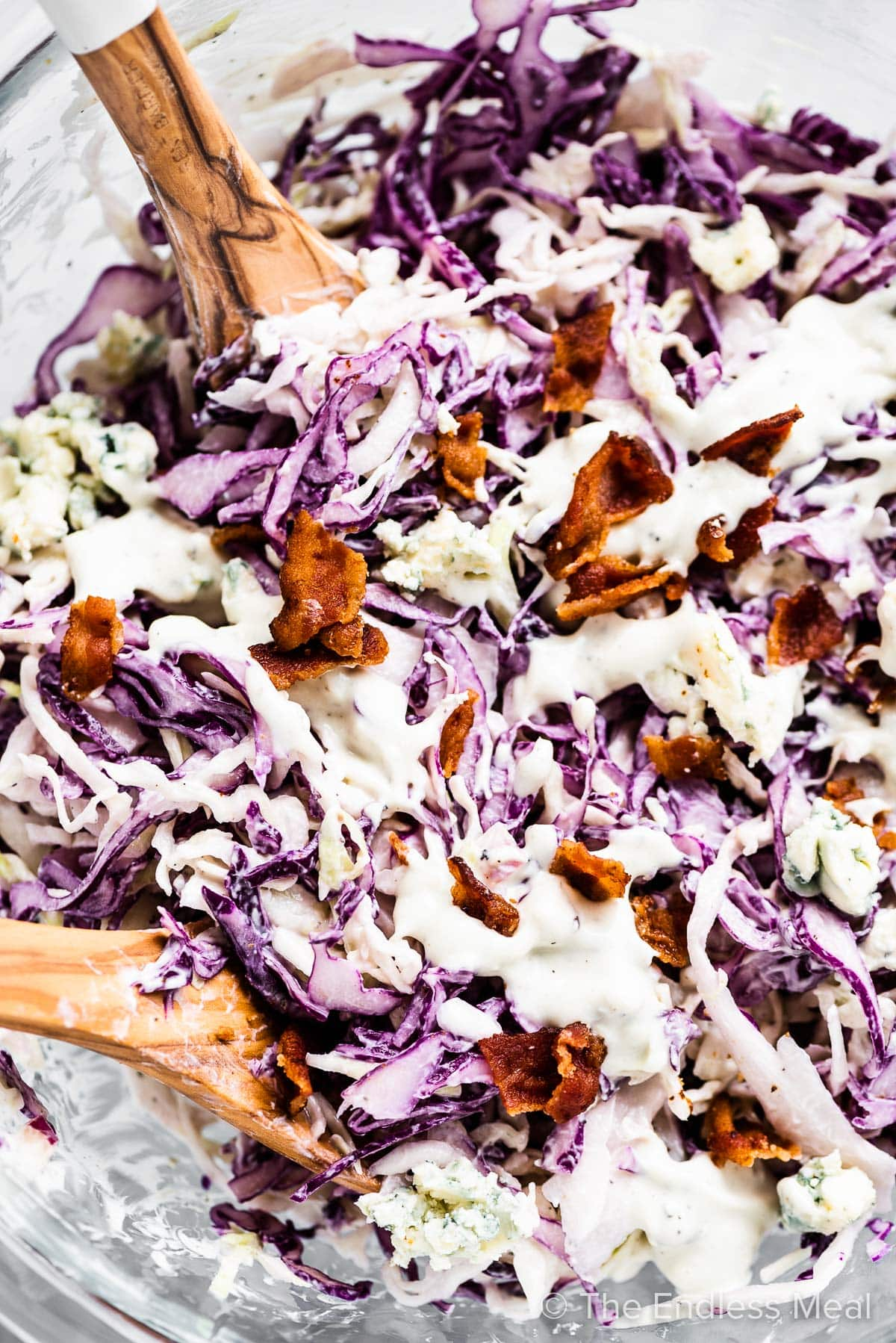 A closeup of Blue Cheese Coleslaw with bacon in a serving bowl.
