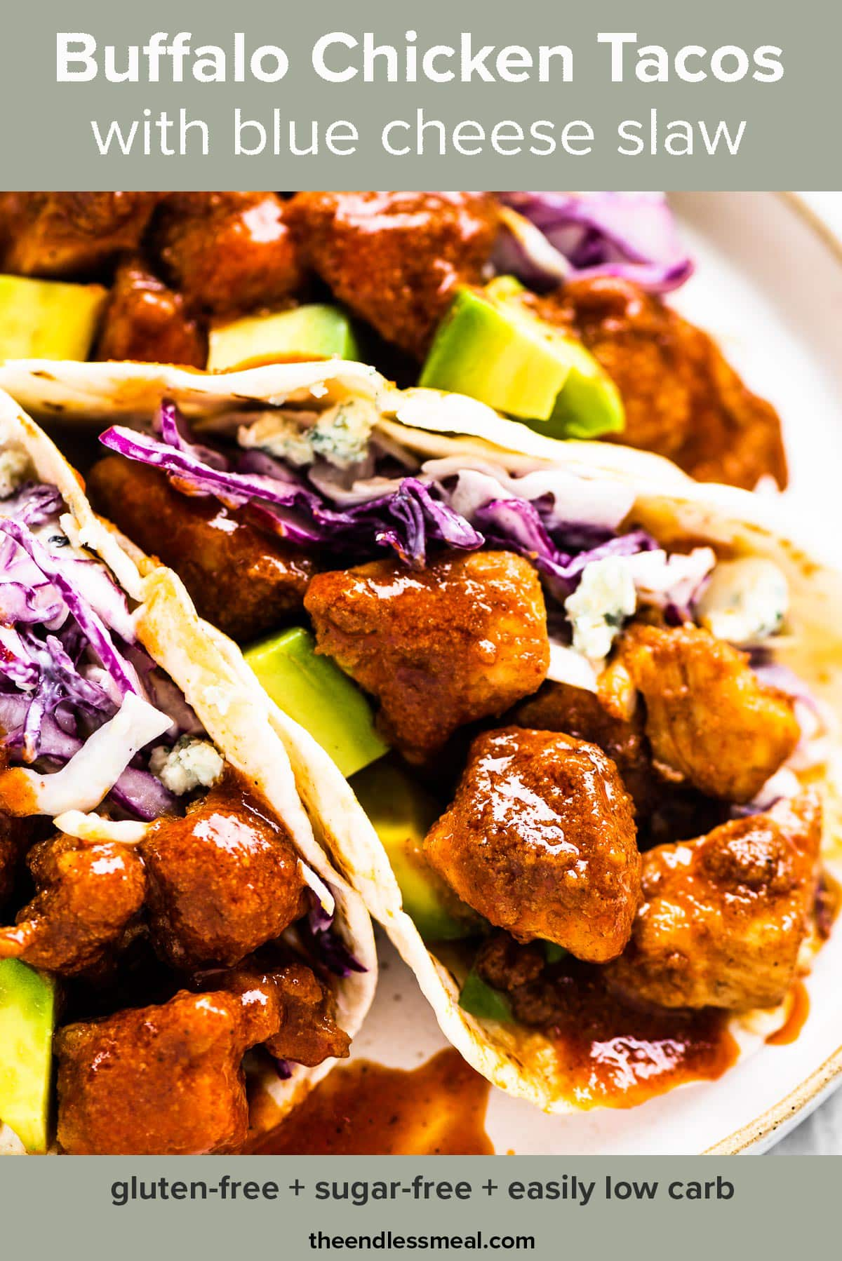 Buffalo chicken tacos with blue cheese slaw on a white plate with the recipe title on top of the picture.