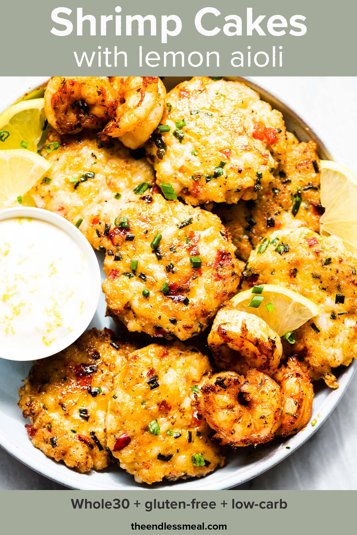 Tender shrimp cakes on a platter with a side of lemon aioli and the recipe title on top of the picture.