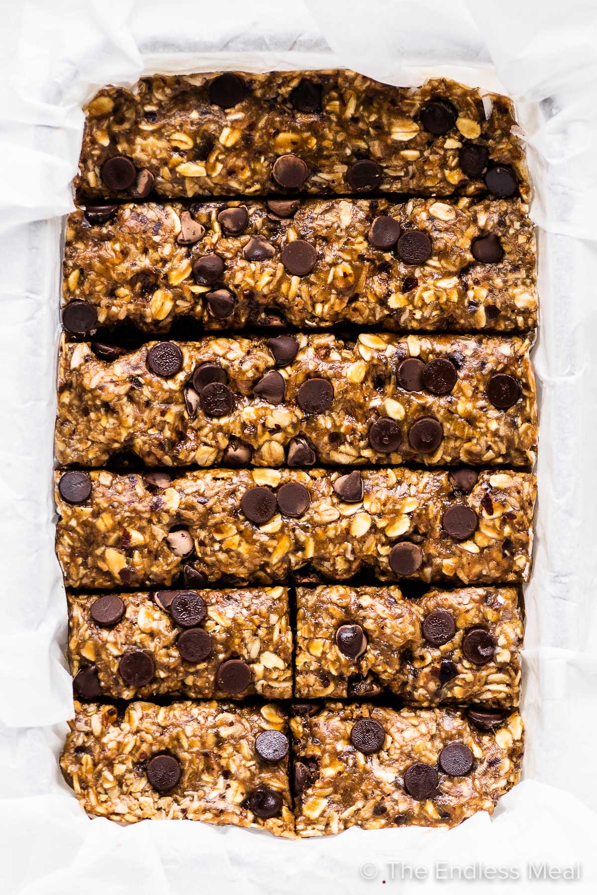 No nut granola bars with chocolate chips in a pan.