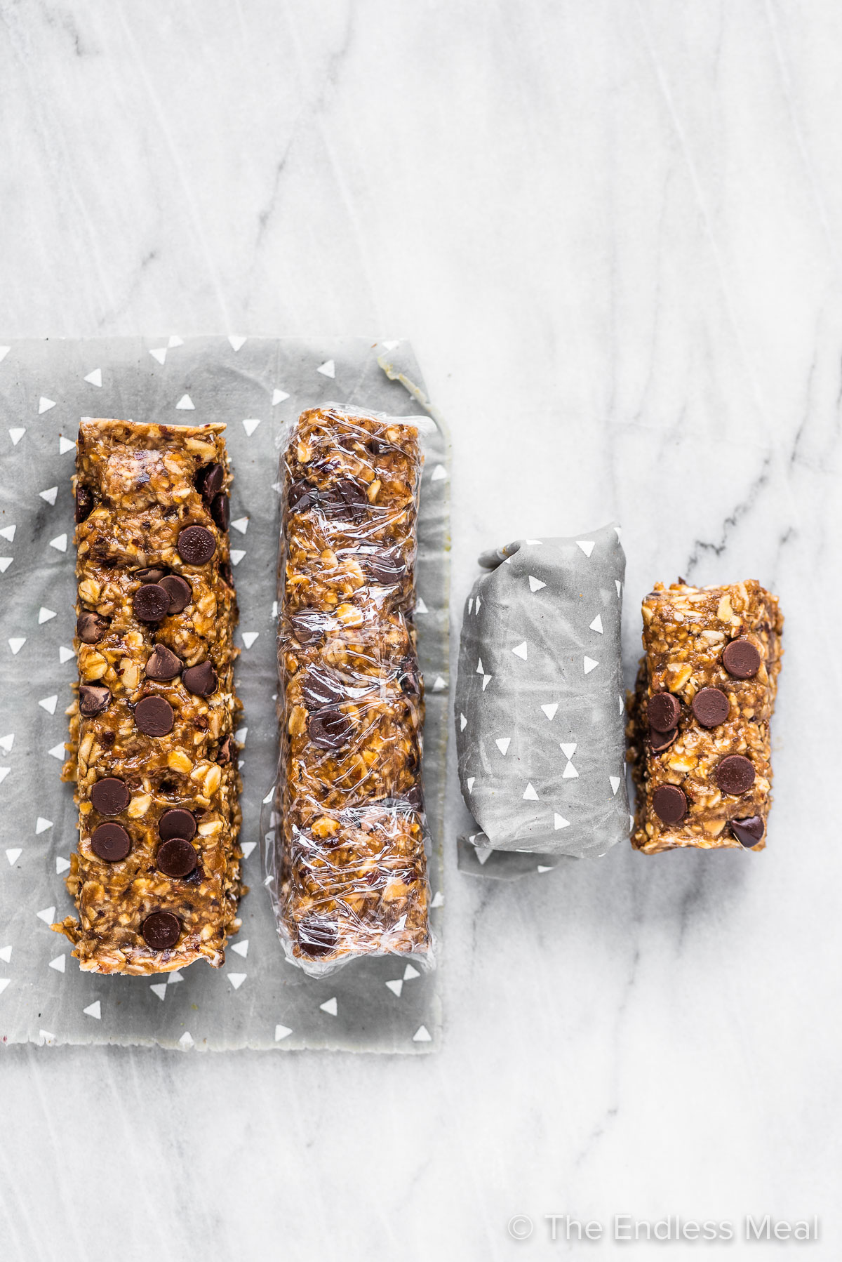 Two sizes of nut free granola bars wrapped and ready for storage.
