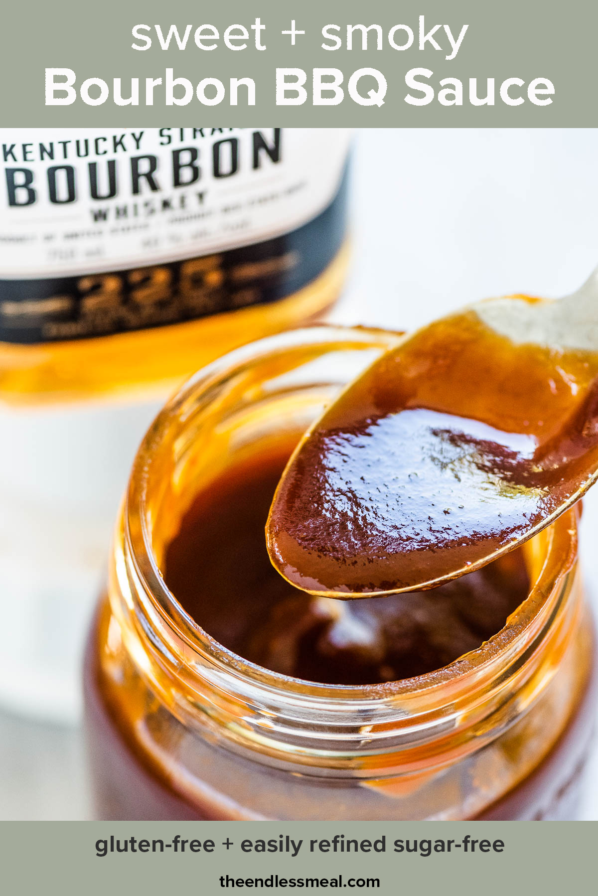 A jar of bourbon bbq sauce with a bottle of bourbon in the background and the recipe title on top of the picture.