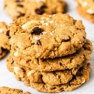 A stack of gluten free peanut butter cookies with chocolate chips.
