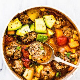 Abo bowl of sopa de albondigas (mexican meatball soup!) with diced avocado.