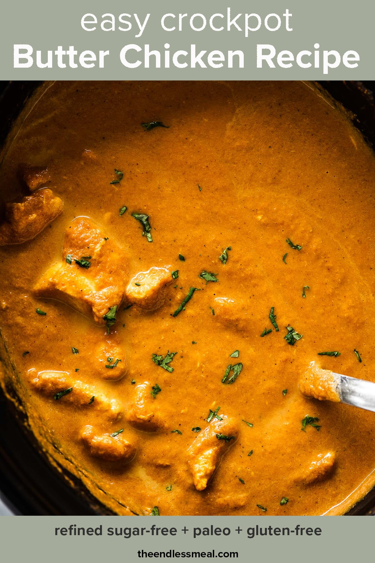 Crockpot Butter Chicken in a slow cooker with the recipe title on top of the picture.