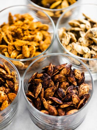 Flavored roasted pumpkin seeds in little dishes.
