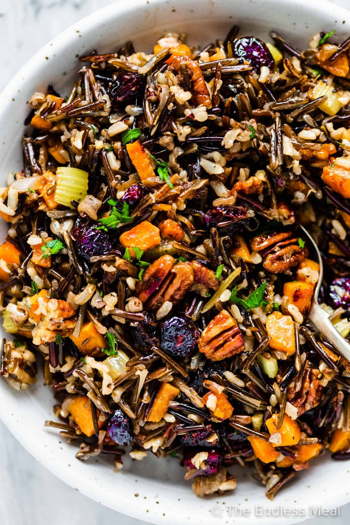 A serving bowl with wild rice stuffing.