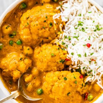 A bowl of cauliflower curry and rice.