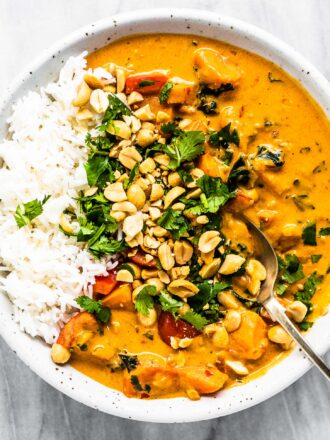 A bowl of peanut curry with rice.