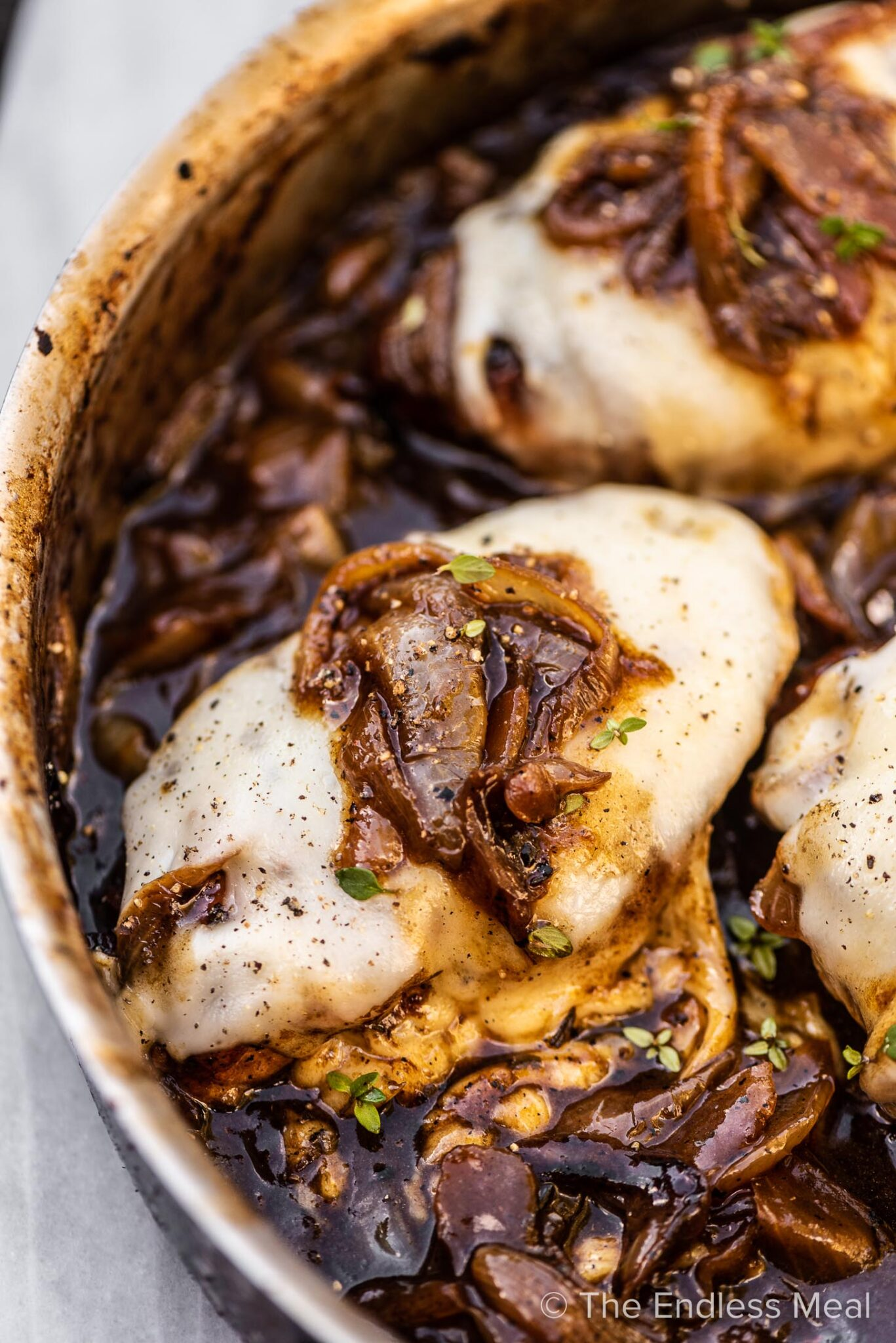 French onion chicken in a pan.