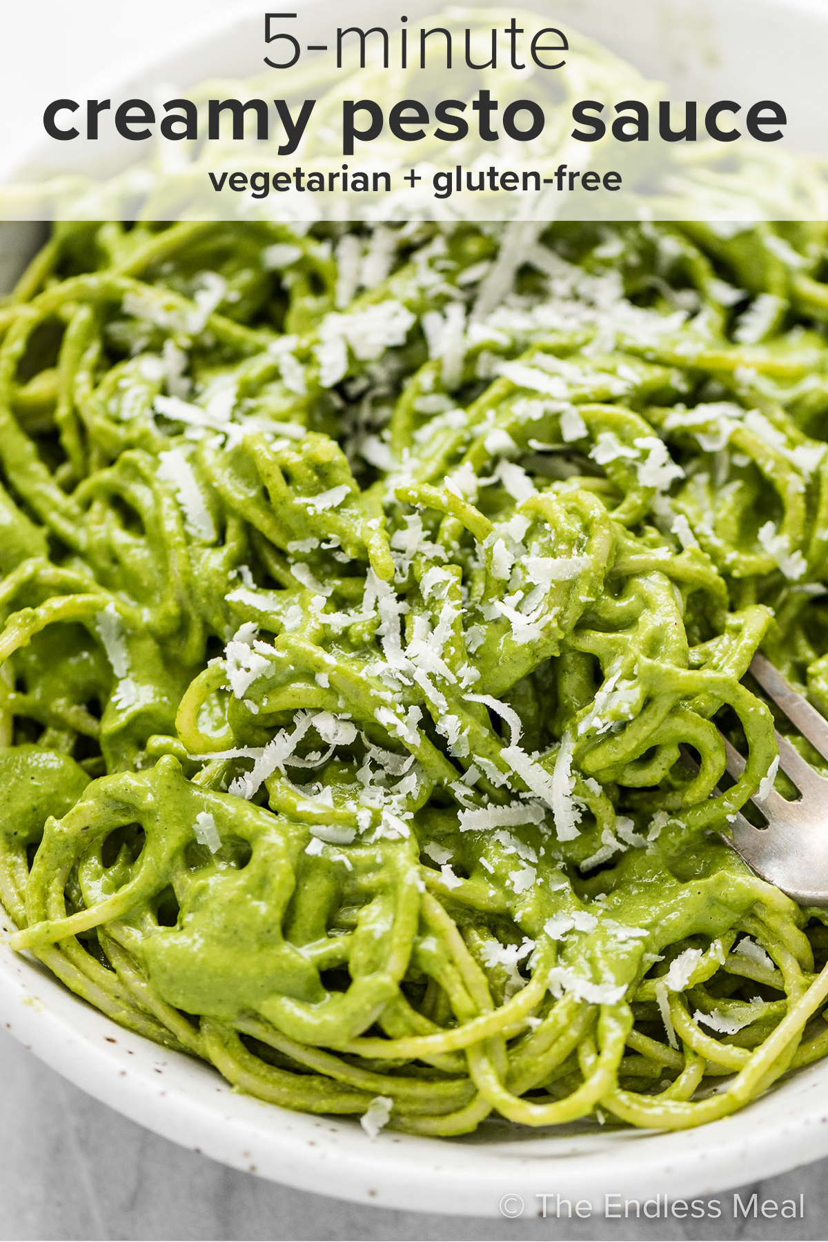 A close up of creamy pesto sauce on pasta and the recipe title on top of the picture.