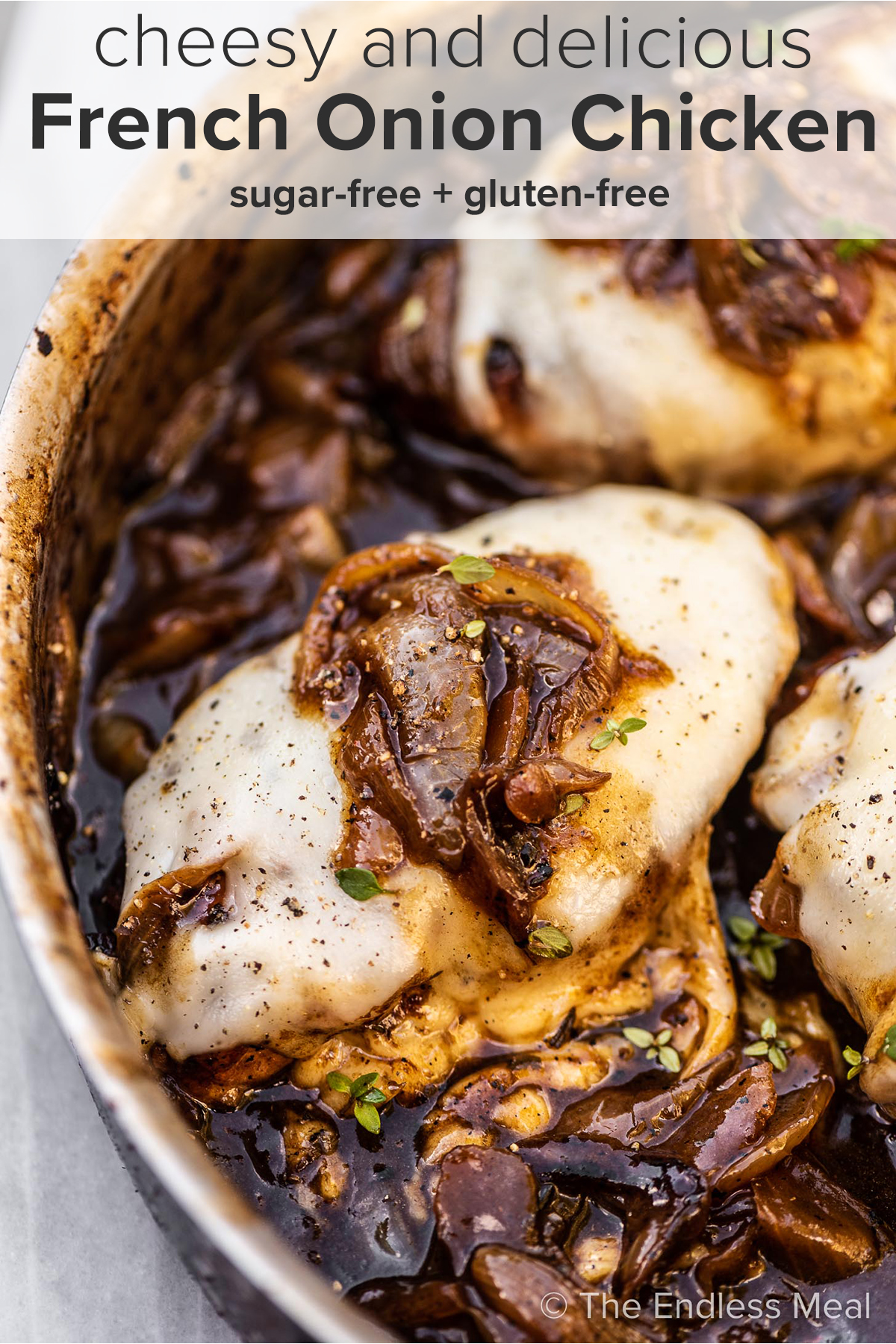 French onion chicken in a pan with the recipe title on top of the picture.
