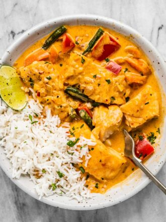 Thai fish curry on a white plate with rice.