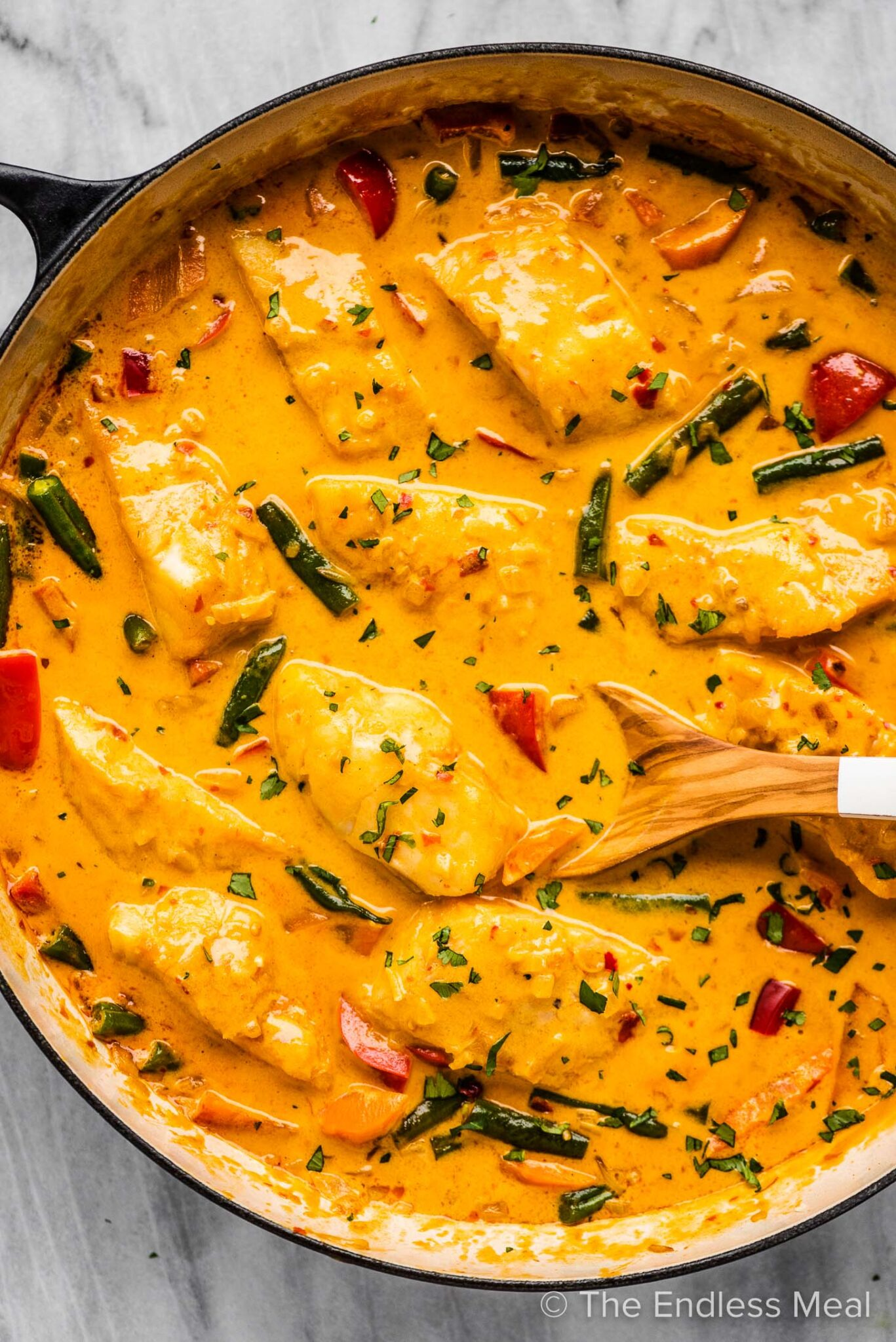 Cooking Thai fish curry in a pot.