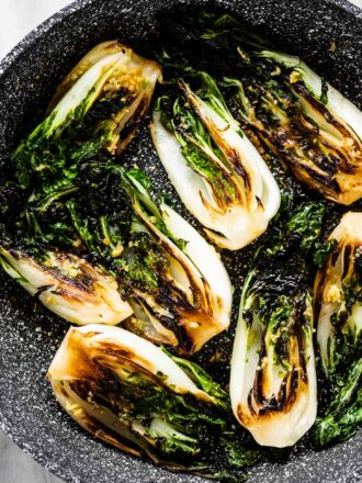 Sautéed Bok Choy in a frying pan.