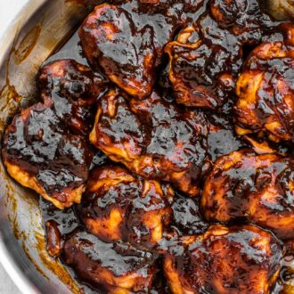 Skillet BBQ chicken in a frying pan.