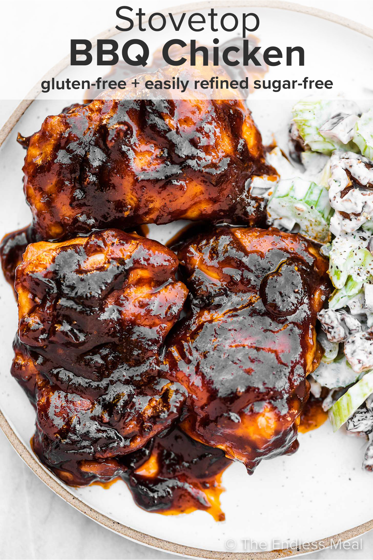 Stovetop BBQ chicken on a plate with celery salad and the recipe title on top of the picture.