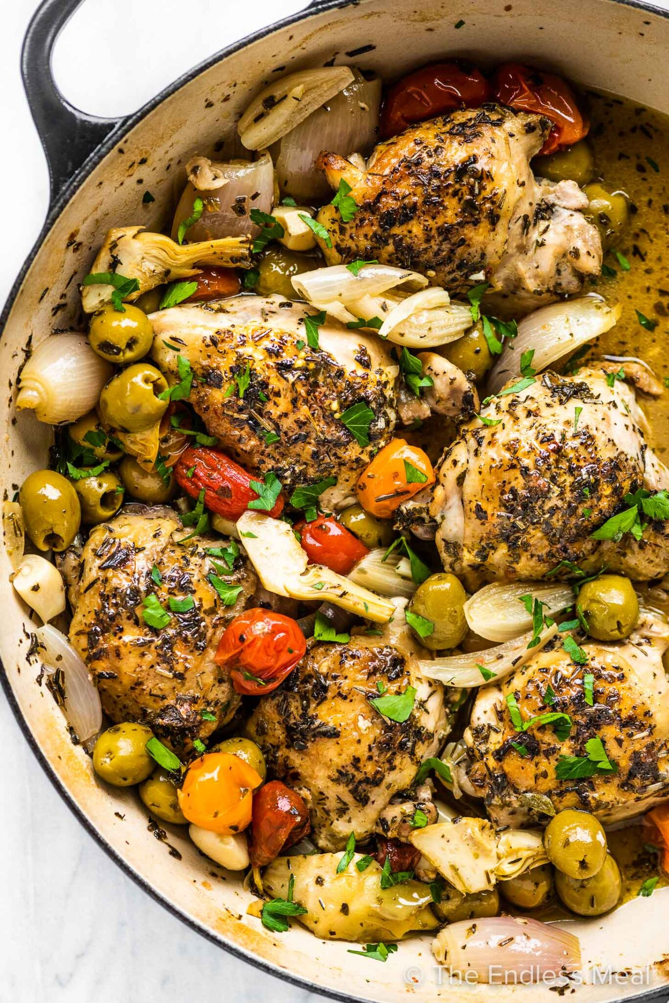 Braised chicken provencal in a pot.