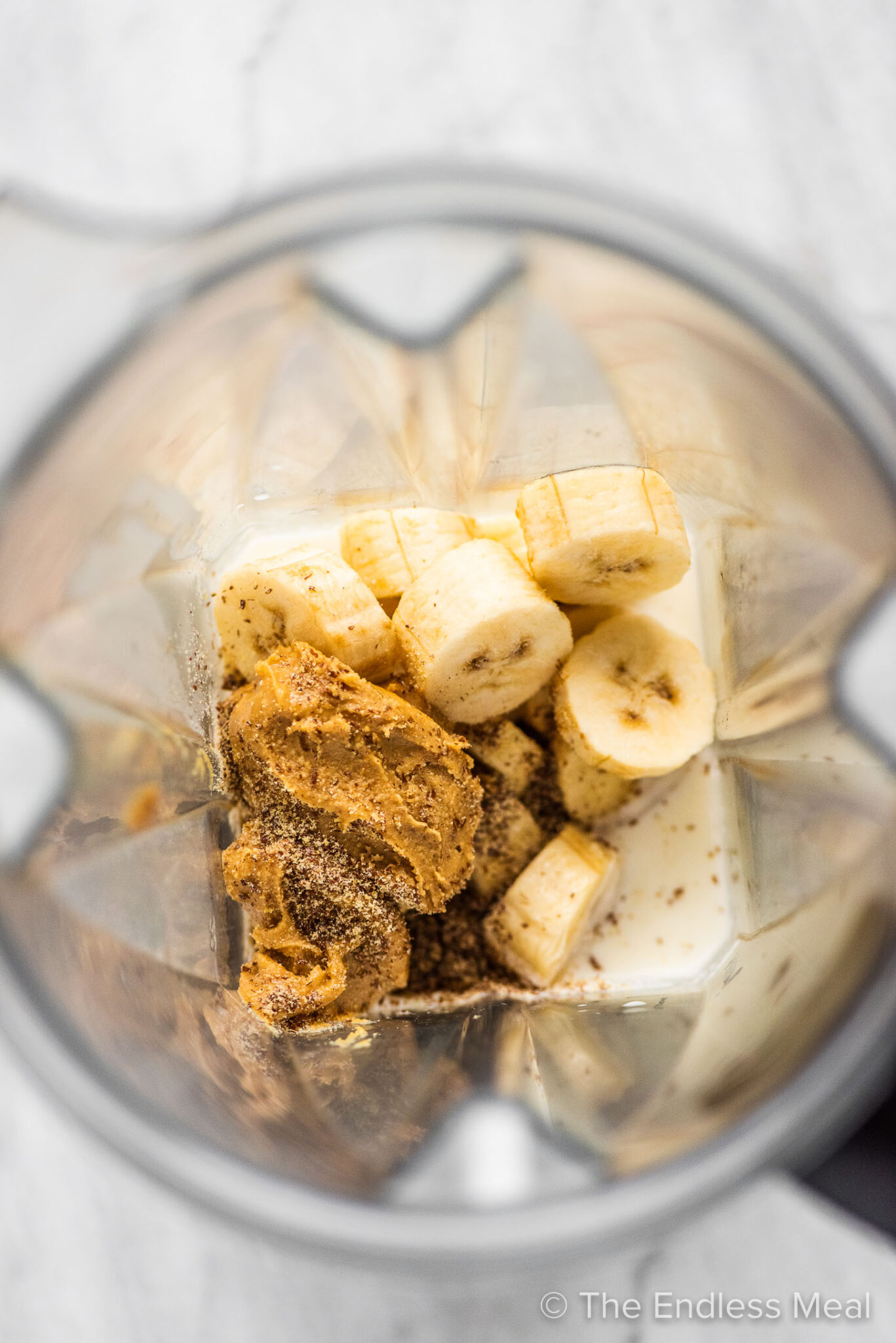 The ingredients for this Peanut Butter Banana Smoothie in a blender.