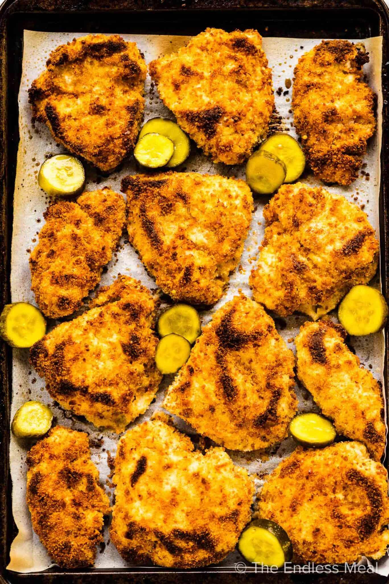 Pickle brine chicken on a baking sheet.