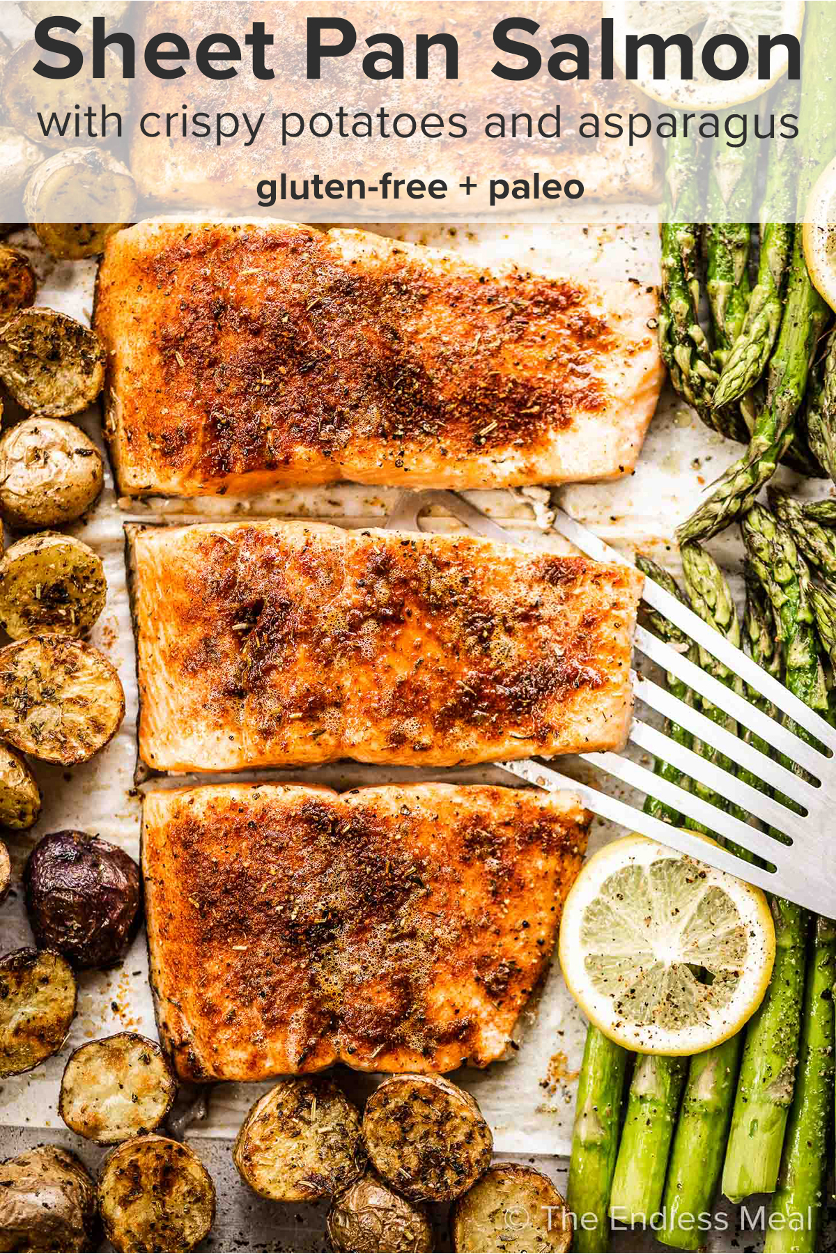 Sheet pan salmon on a baking sheet with potatoes and asparagus and the recipe title on top of the picture.