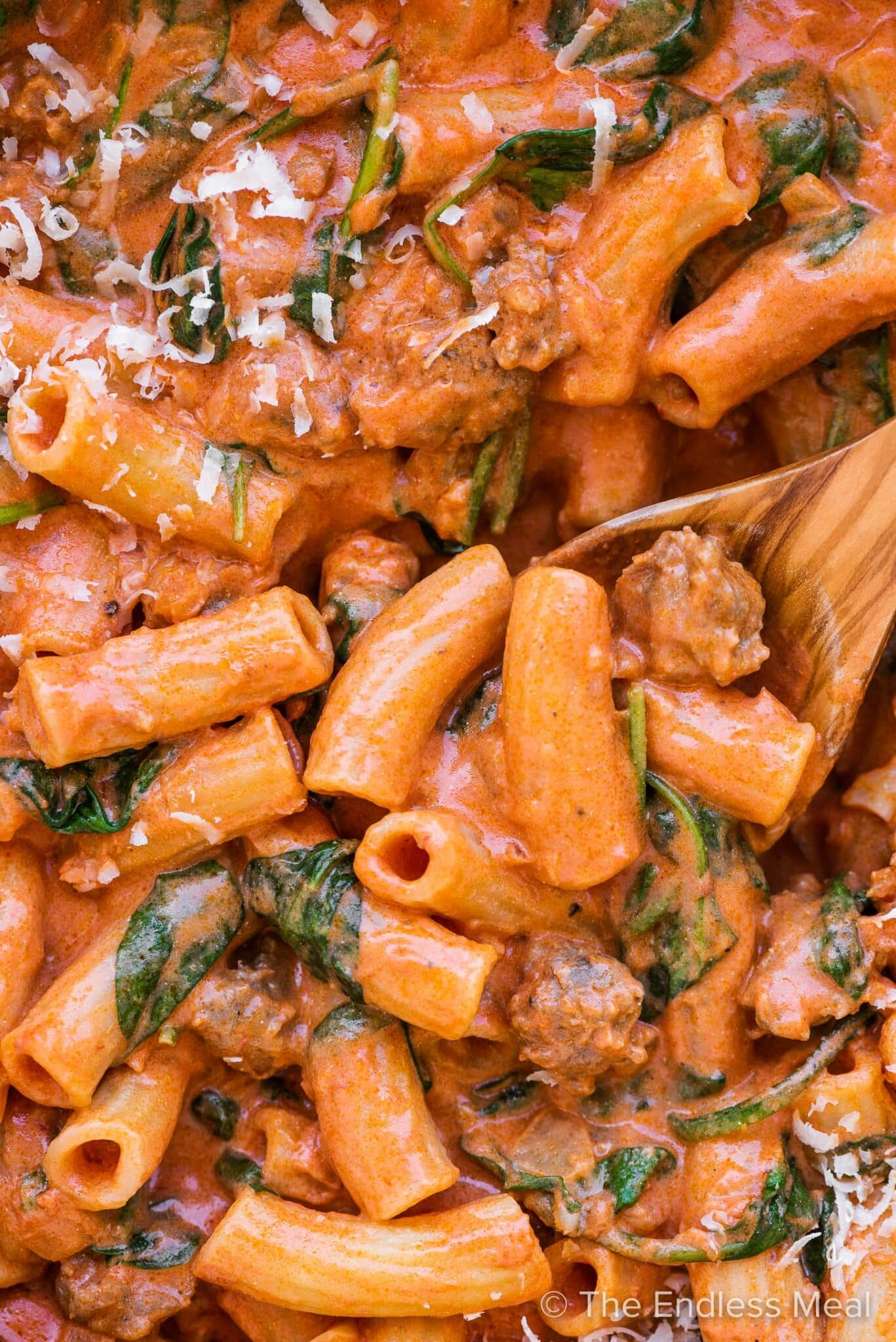 A close up of Italian sausage pasta in a pot.