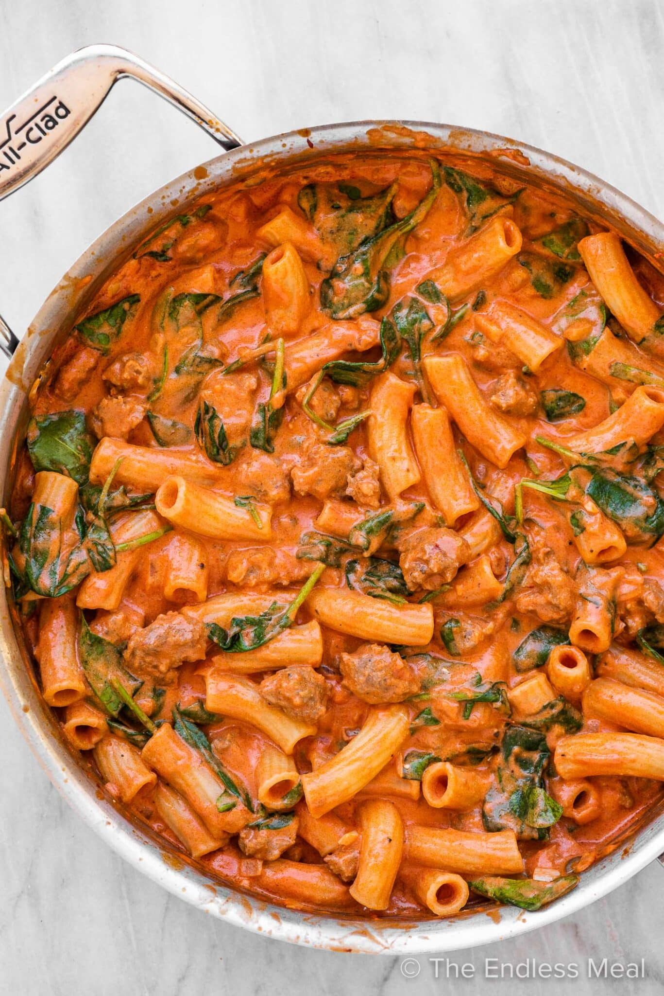 Italian sausage pasta in a skillet.