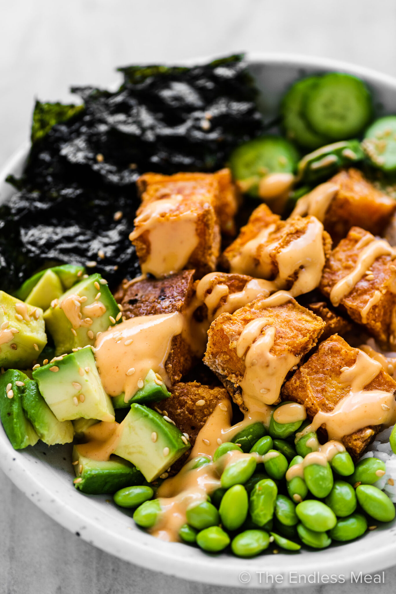A Sushi Bowl with crispy sweet potatoes.