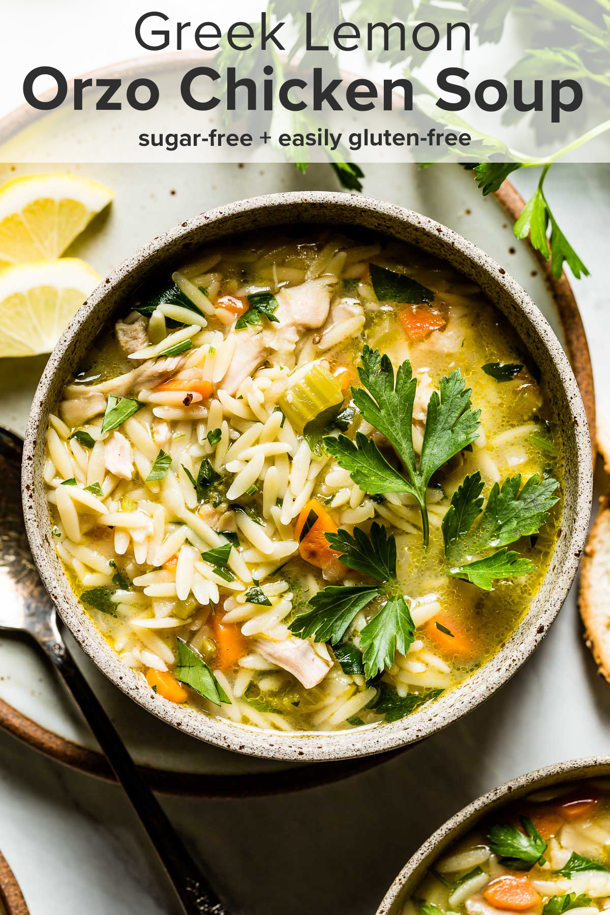 Lemon chicken orzo soup in a bowl with the recipe title on top of the picture.