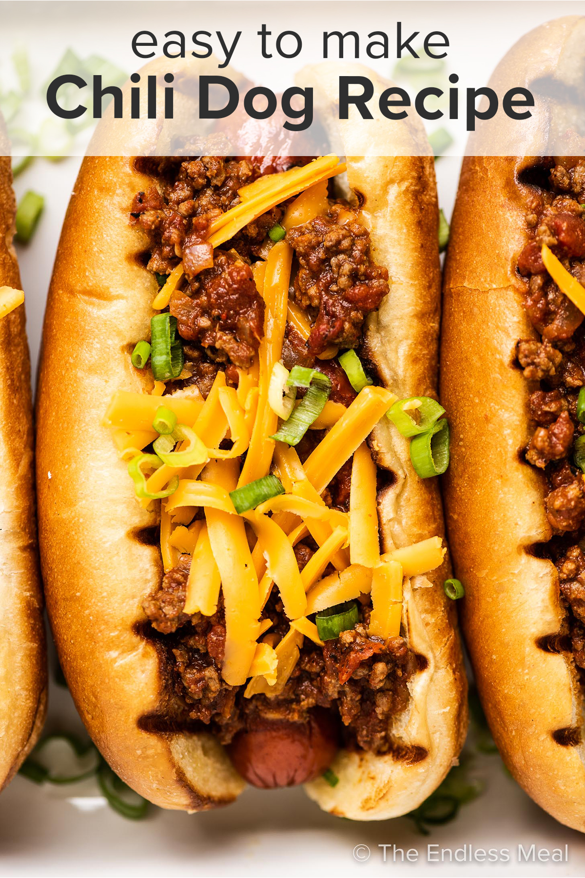 A close up of a chili cheese dog and the recipe title on top of the picture.