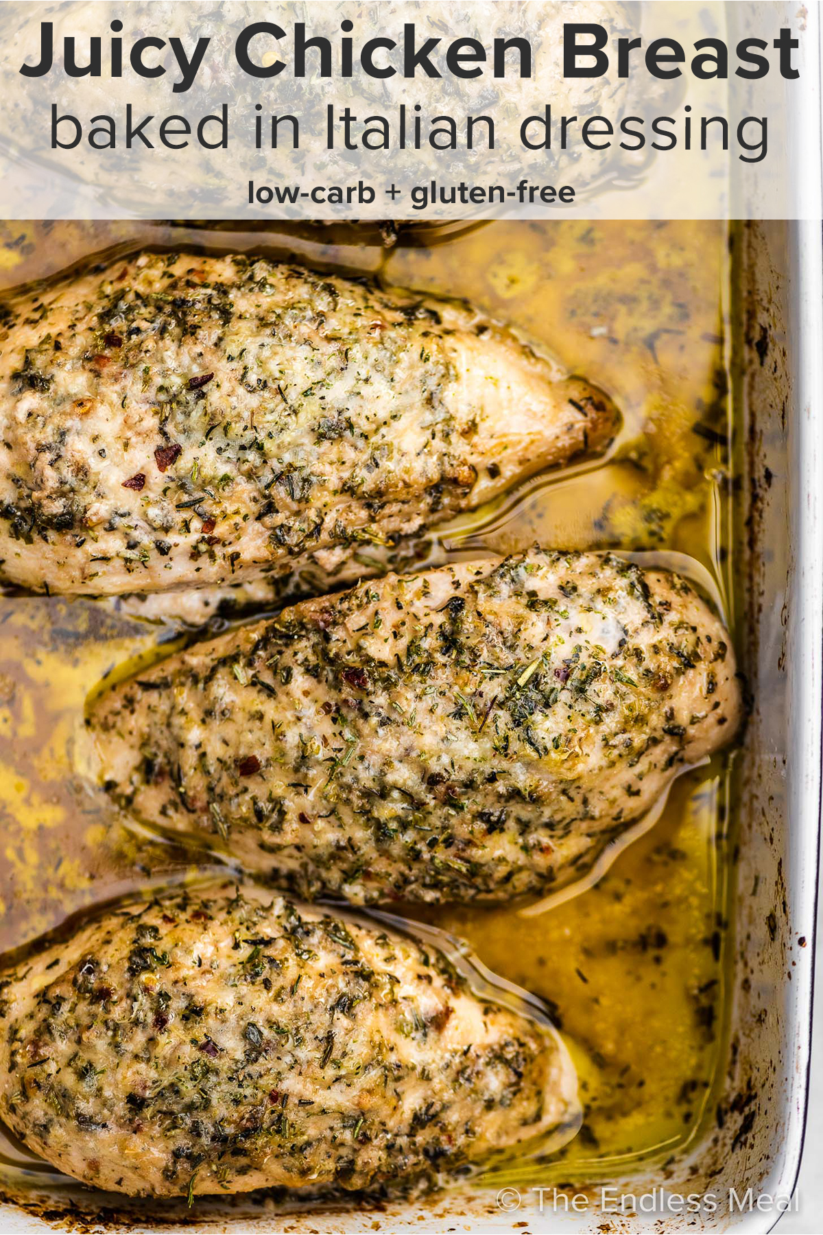 A closeup of Italian dressing chicken in a baking dish with the recipe title on top of the picture.