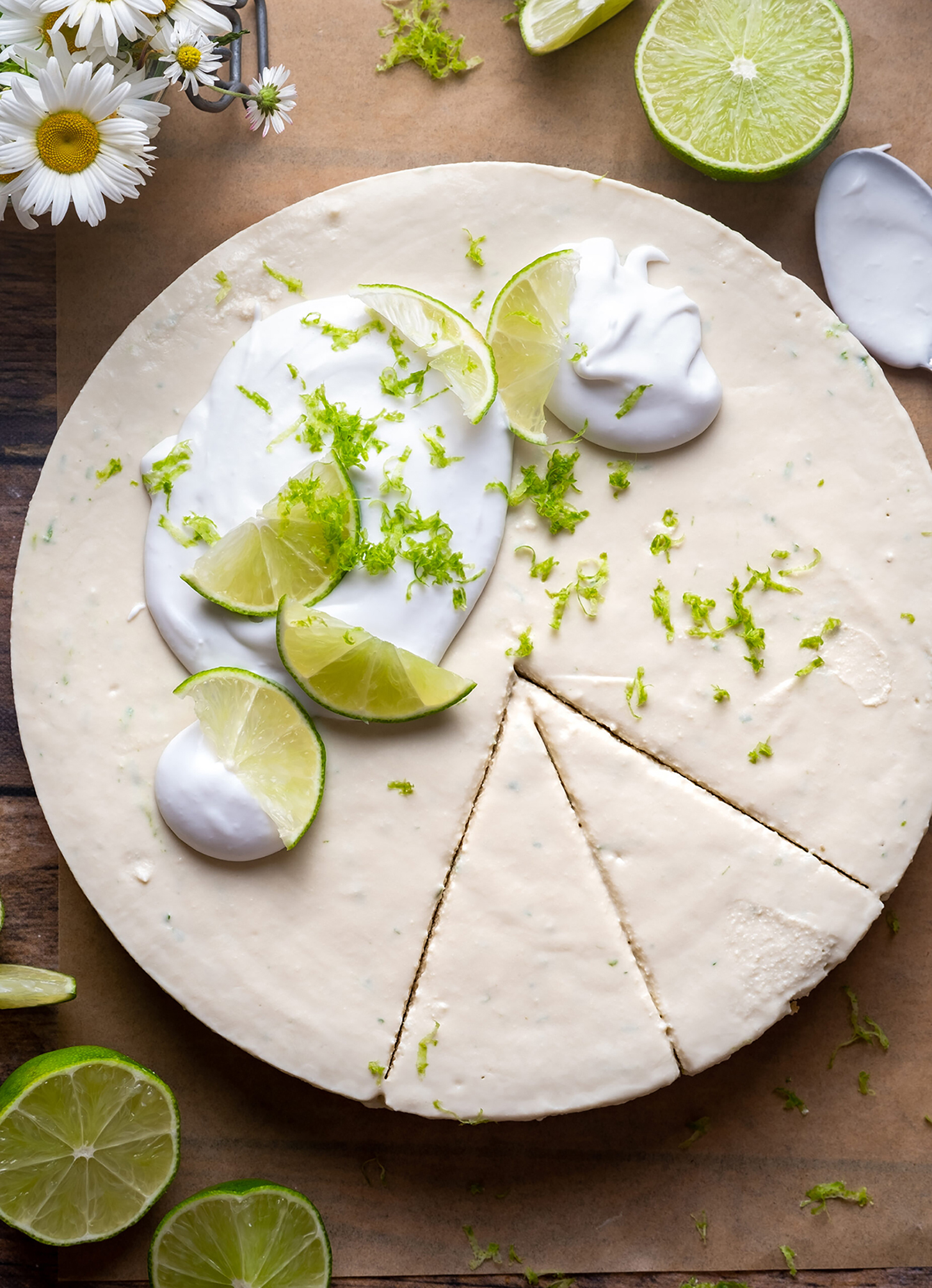 Healthy Key Lime Pie cut into slices with whipped cream on top.