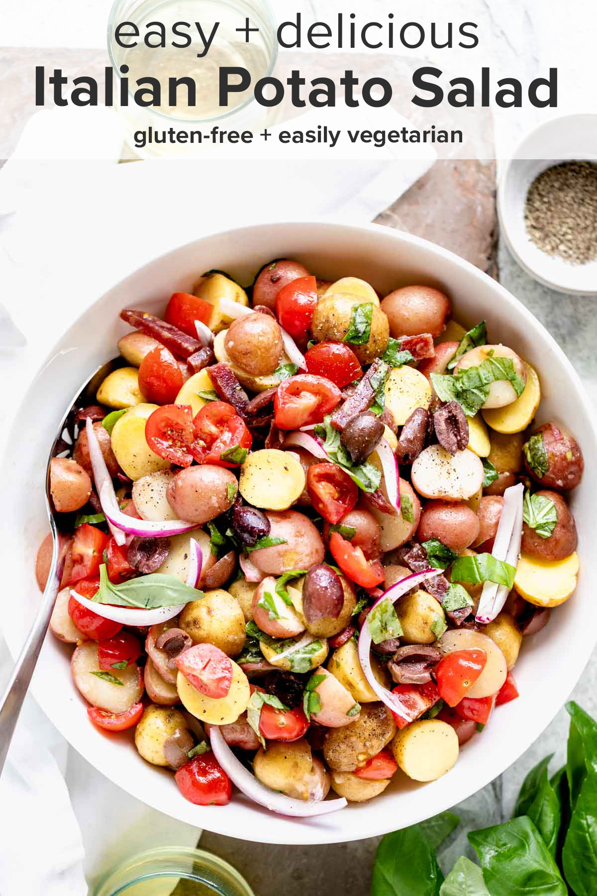 overhead view of the Italian potato salad in a white bowl and the recipe title on top of the picture.