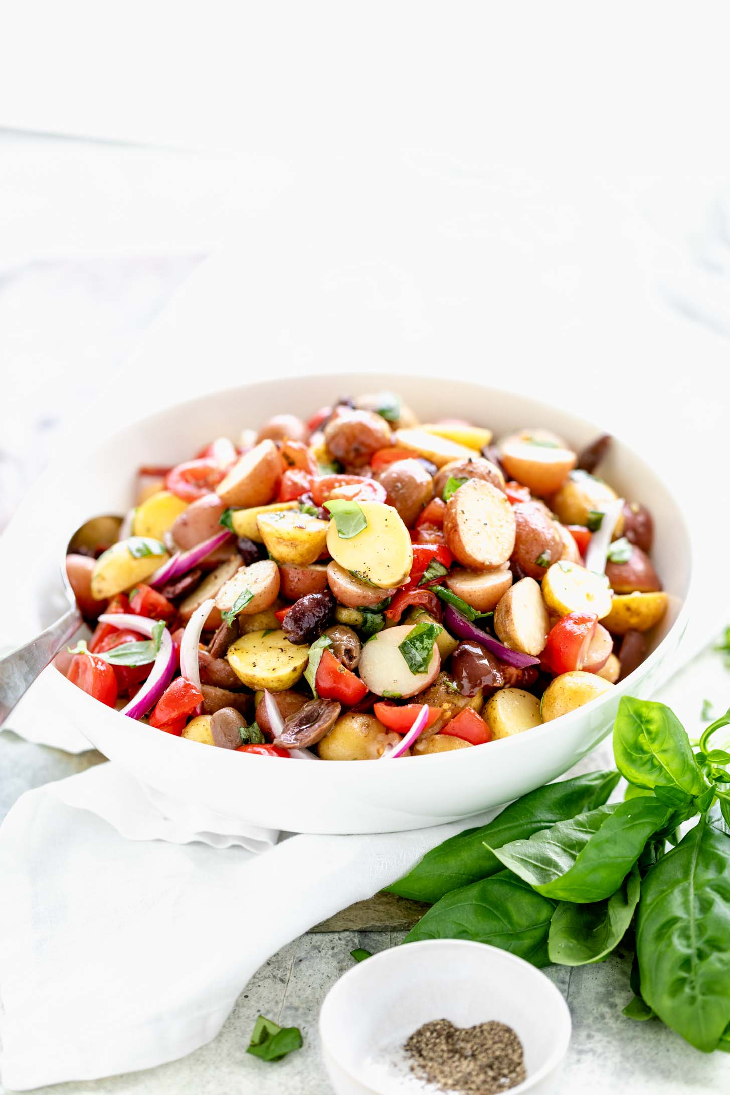 side view of Italian potato salad with a spoon in it
