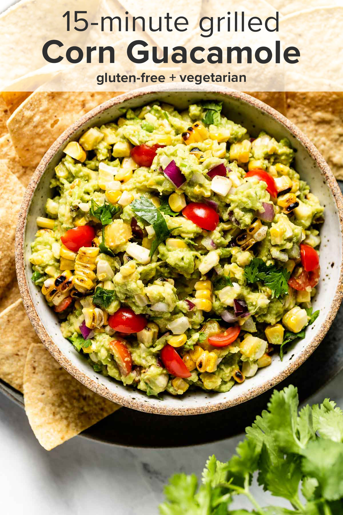 A bowl of corn guacamole from the top view with the recipe title on top of the picture.