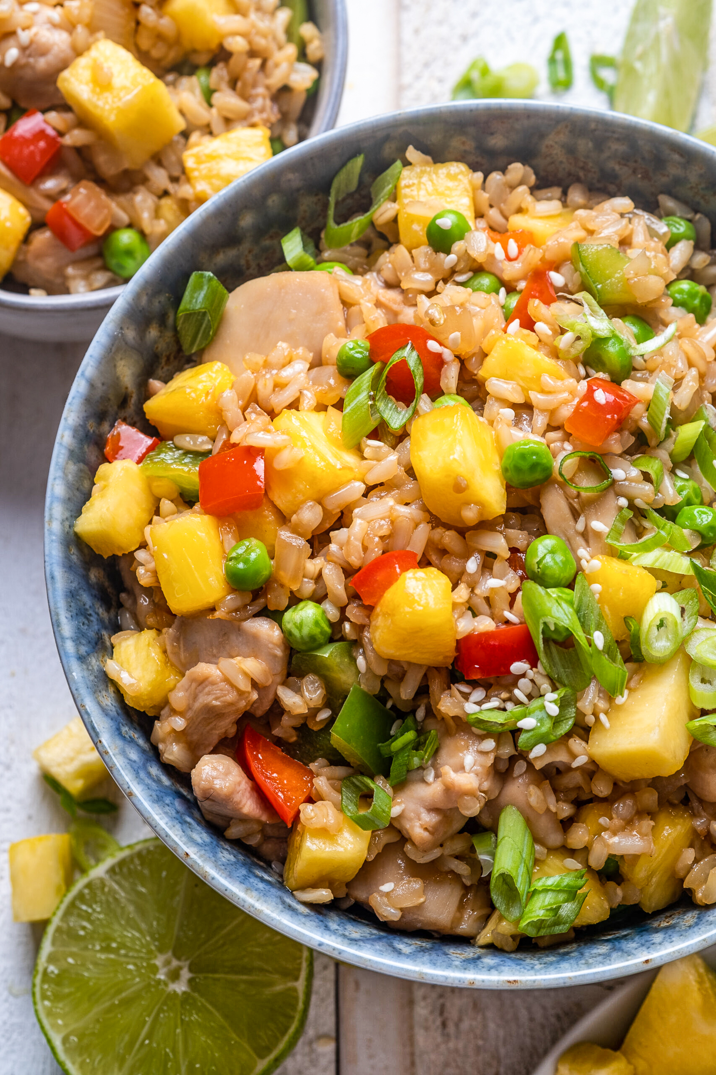 Pineapple chicken fried rice in a serving bowl.