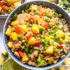 Pineapple fried rice in a blue bowl.