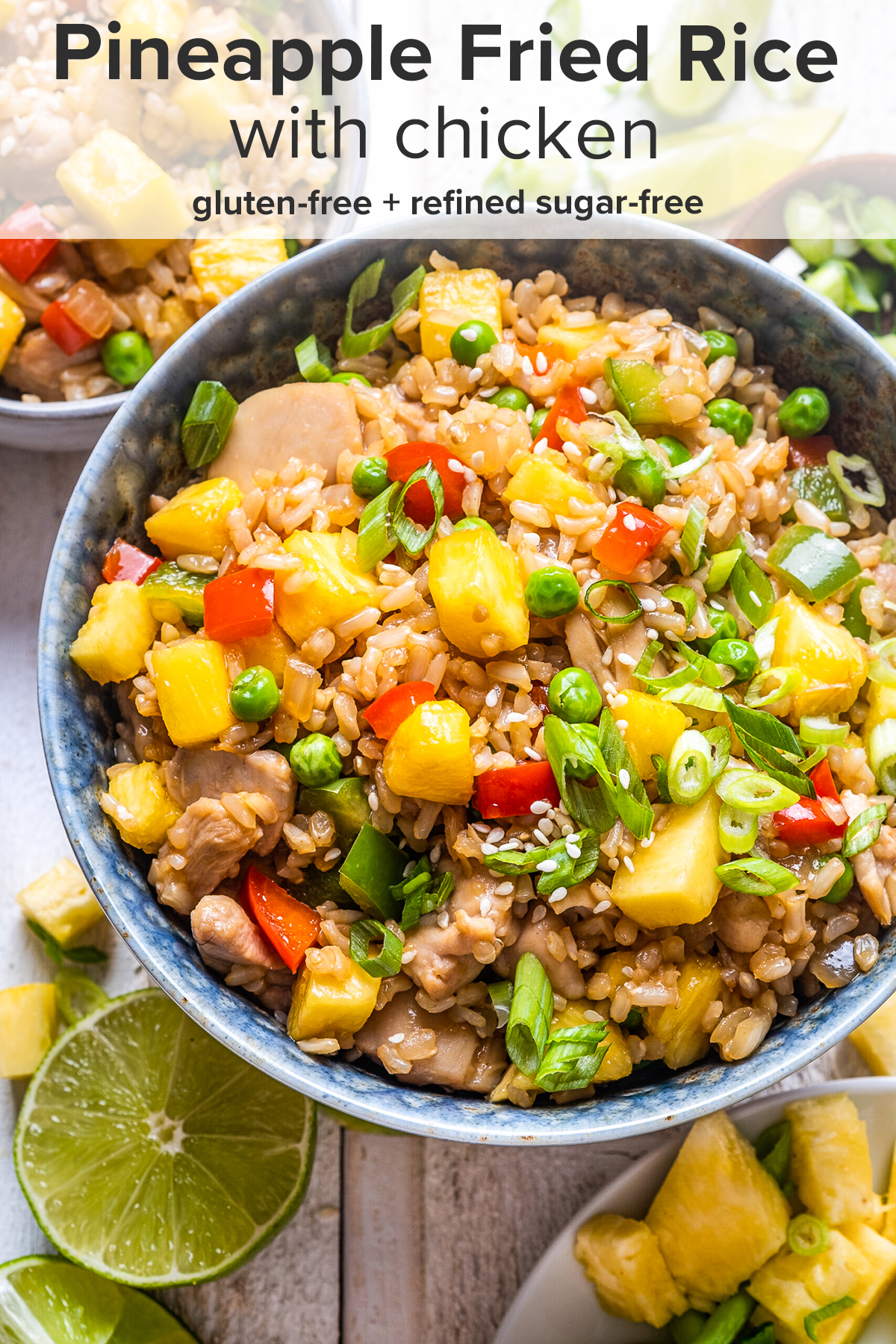 Pineapple fried rice in a blue bowl with the recipe title on top of the picture.