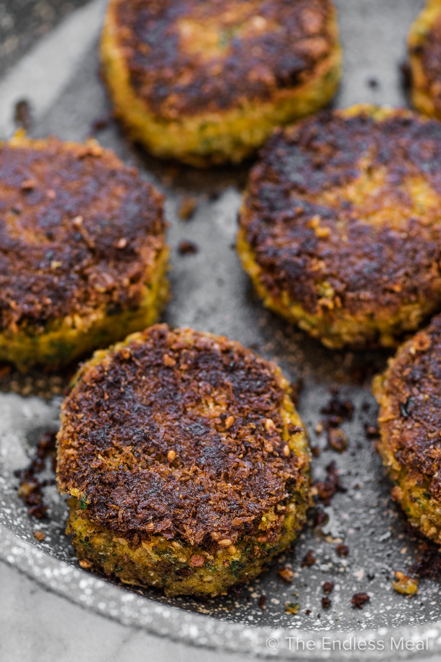 A closeup of Chickpea Pumpkin Fritters in a pan.