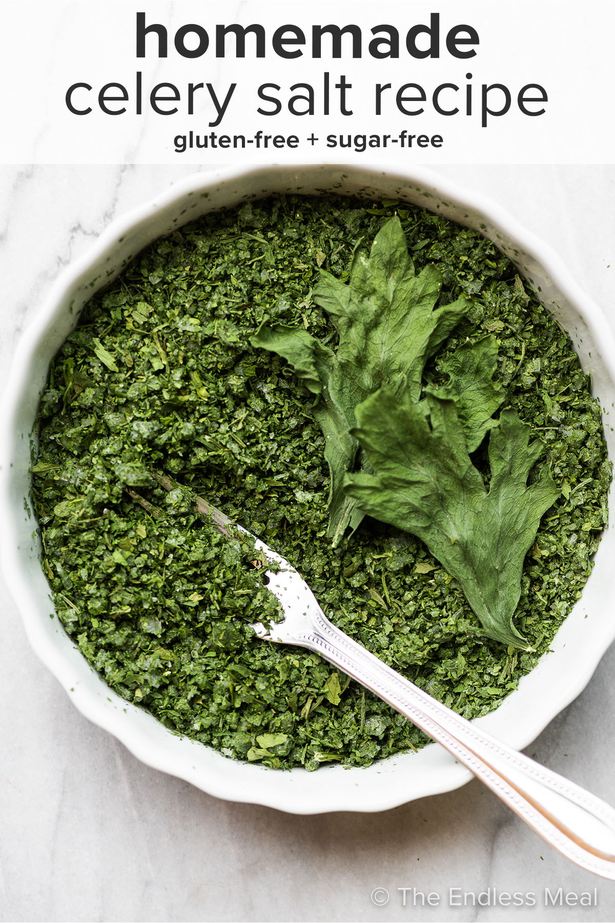 Celery leaf salt in a mixing bowl with the recipe title on top of the picture.